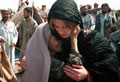 an old refugee woman thanking Jemima