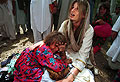 Jemima with a refugee child at Jalozai