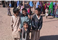 boys laughing outside the clinic at Jalozai